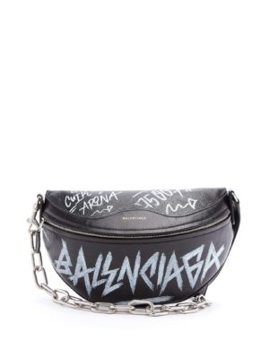 Balenciaga Logos movement featured by top high end fashion blog, A Few Goddy Gumdrops: image of a Balenciaga graffiti fanny pack