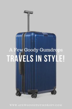 A Few Goody Gumdrops Travels In Style  | Chic luggage featured by top high end life and style blog, A Few Goody Gumdrops: image of a blue Rimowa trolley luggage