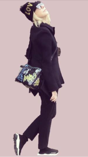 Balenciaga Logos movement featured by top high end fashion blog, A Few Goddy Gumdrops: image of a blonde woman wearing a crossbody shoulder Balenciago bag