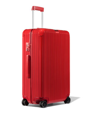 | Chic luggage featured by top high end life and style blog, A Few Goody Gumdrops: image of a red Rimowa trolley luggage