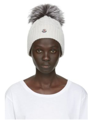 Stay Warm and Fashionable in Chunky Knits featured by top US high end fashion blog, A Few Goody Gumdrops: image of Moncler pom beanie