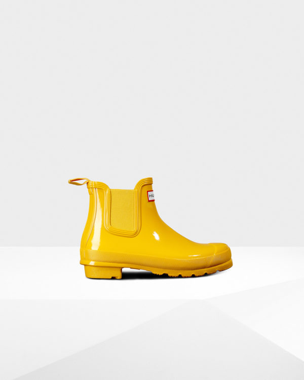 High end fashion blogger, A Few Goody Gumdrops shares designer short rain boots for a rainy day.