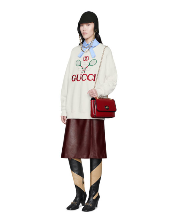 High end fashion blogger, A Few Goody Gumdrops shares her obsession for designer logo sweatshirts: image of a Gucci sweatshirt