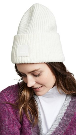 High end fashion blogger, A Few Goody Gumdrops shares winter white fashion