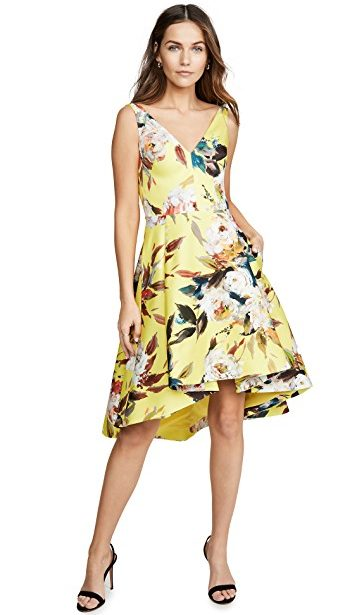 Yellow floral Spring trend featured by top high end fashion blog, A Few Goody Gumdrops: image of a woman wearing a Black Halo yellow floral dress