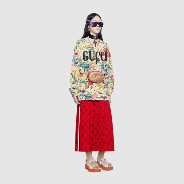 High end fashion blogger, A Few Goody Gumdrops shares her obsession for designer logo sweatshirts: image of a floral Gucci sweatshirt