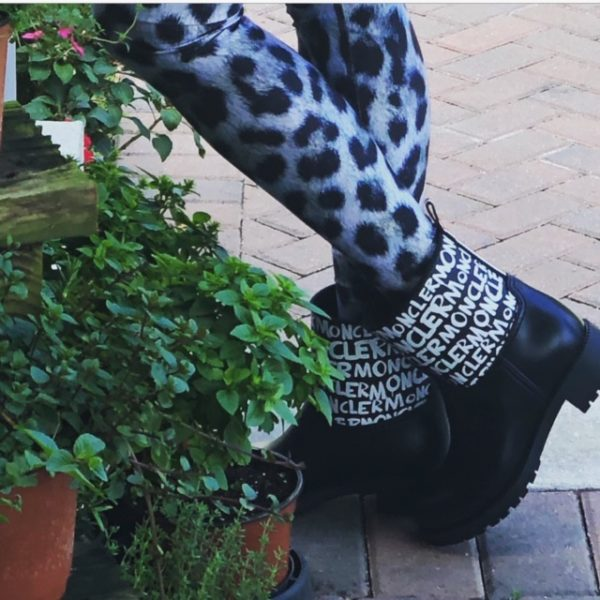 Short rain boots trend featured by top US high end fashion blog, A Few Goody Gumdrops: image of a woman wearing black Moncler short rain boots and leopard leggings
