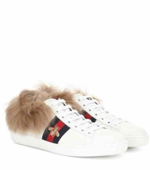 The White Sneaker Trend reviewed by top US high end fashion blog, A Few Goody Gumdrops: image of Gucci bee white sneakers