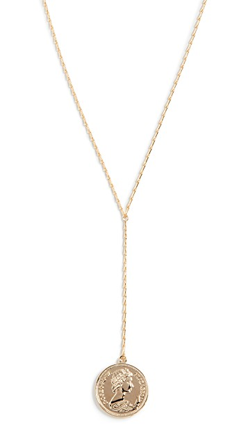 Top US High end fashion blog, A Few Goody Gumdrops shares the latest gold coin necklaces: image of Sashi pendant gold coin necklaces