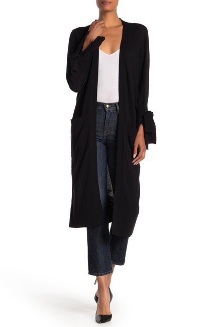 High-end fashion blogger, A Few Goody Gumdrops swears by the long duster sweater.