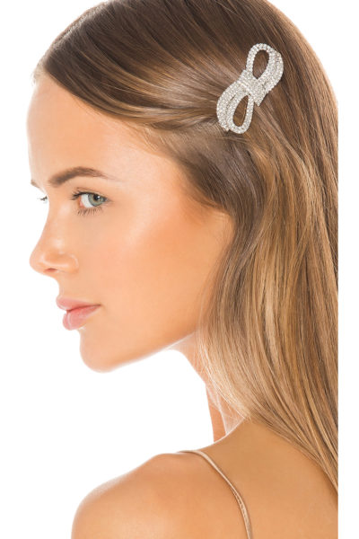 Trendy Hair Clips and Barrettes featured by top US high end fashion blog, A Few Goody Gumdrops: image of a woman wearing a Jennifer Behr glitzy barrette