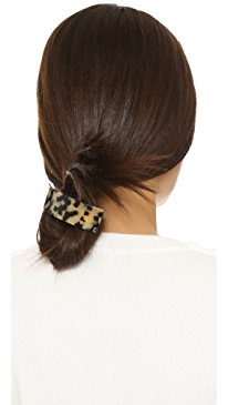 Trendy Hair Clips and Barrettes featured by top US high end fashion blog, A Few Goody Gumdrops: image of a woman wearing an Alexandre de Paris thick hair clip
