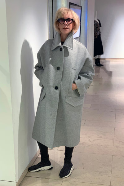 Cocoon winter coat shopping guide featured by top US high end fashion blog, A Few Goody Gumdrops: image of a woman wearing Givenchy cocoon winter coat