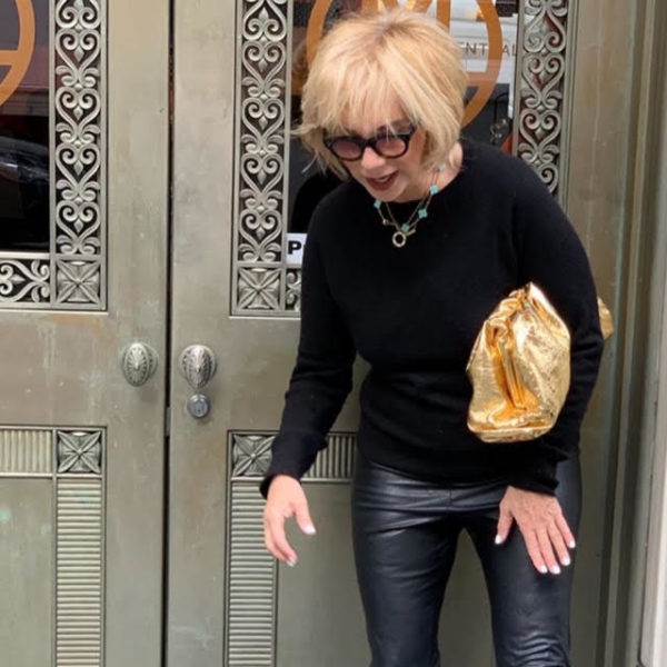 Bottega Veneta Bags featured by top US high end fashion blog, A Few Goody Gumdrops: image of a woman wearing a Bottega Veneta The Pouch