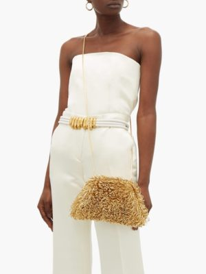 Designer Sponge Bag Roundup featured by top US high end fashion blog, A Few Goody Gumdrops: image of a woman with a Bottega Veneta Sponge Pouch