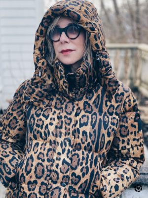 Animal print trend featured by top US high end fashion blog, A Few Goody Gumdrops: image of a woman wearing a SAM leopard print puffer coat