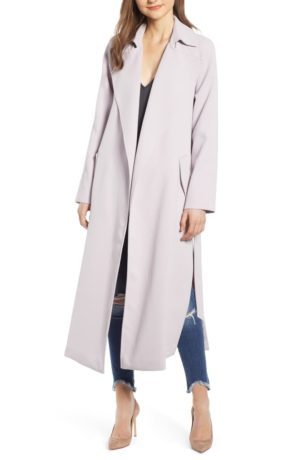 Light raincoats featured by top US high end fashion blog, A Few Goody Gumdrops: image of Kendell and Kylie split trench raincoat