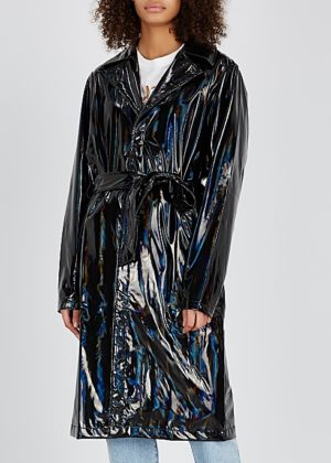 Light raincoats featured by top US high end fashion blog, A Few Goody Gumdrops: image of Rains holographic raincoat