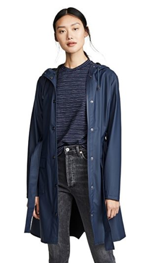 Light raincoats featured by top US high end fashion blog, A Few Goody Gumdrops: image of Rains Curve Jacket